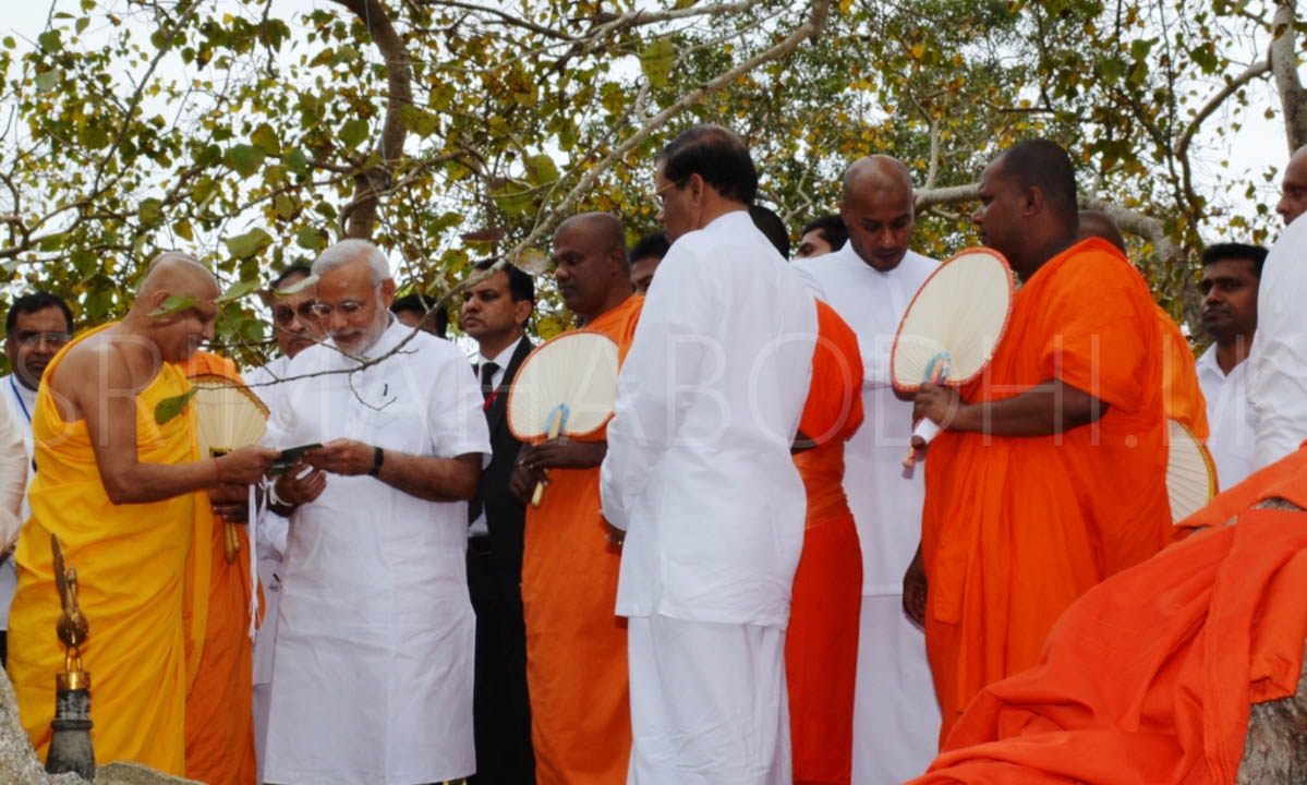 14_Atamasthanadhipathi_Nayaka_Thero_presenting_the_book_on_Jaya_Sri_Maha_Bodhi_to_PM_Modi