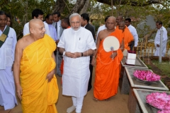 15_PM_Modi_leaving_the_Udamaluwa_with_Atamasthanadhipathi_Nayaka_Thero